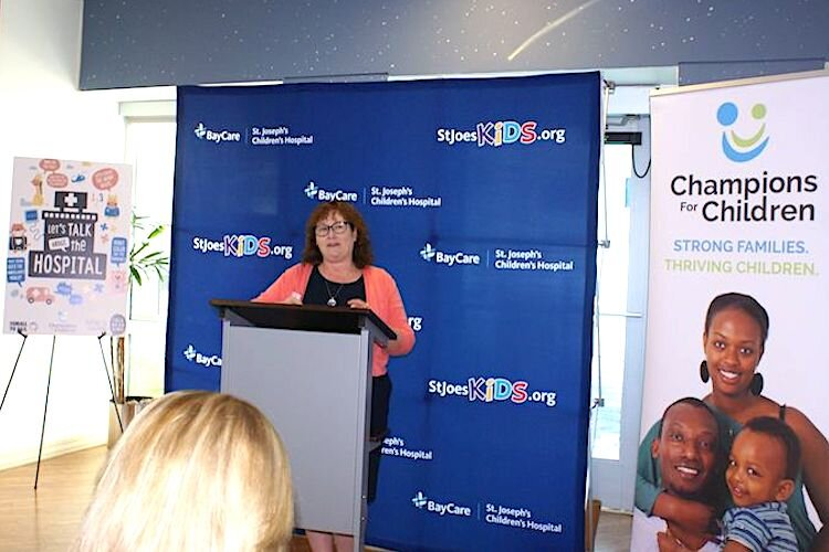Amy Haile, Executive Director of Champions for Children in Tampa, announces launch of Talk, Read, Sing initiative.
