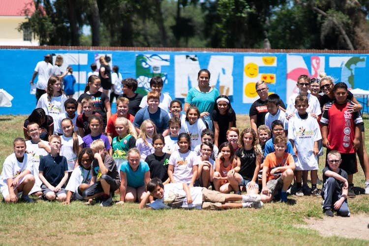Painting with a Purpose at Buckhorn Elementary School created a large mural on the back fence of the school property.