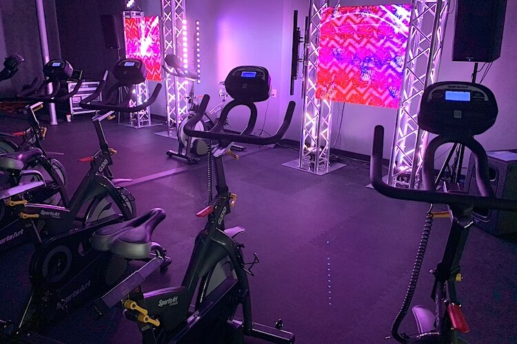 Creative lights and music create different moods for spinning classes.