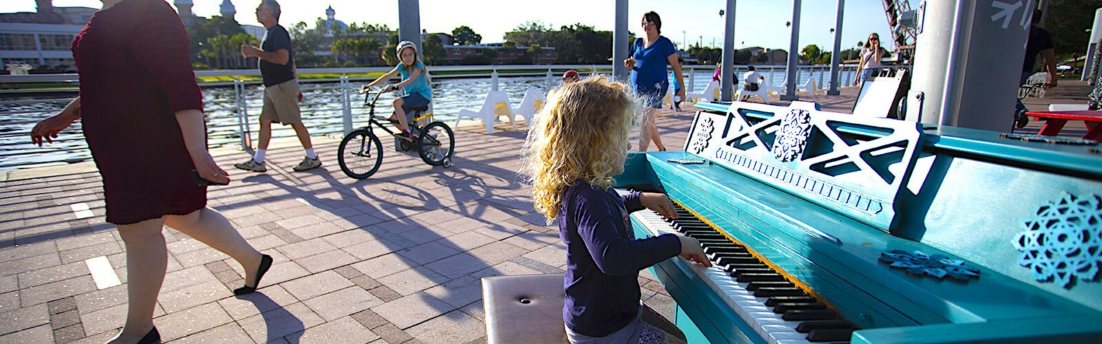 "Winter Village at Curtis Hixon Park is complete with a ""street piano"" adorned with snowflakes for the holidays."