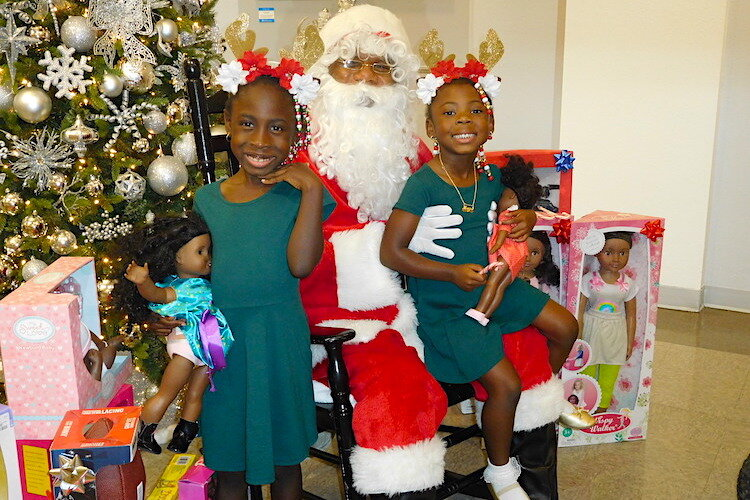 Santa and his elves at the Woodson holiday open house.