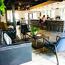 Visitors to Ybor Beverage Co. can settle into a comfy sofa, lounge chairs, or barstools.