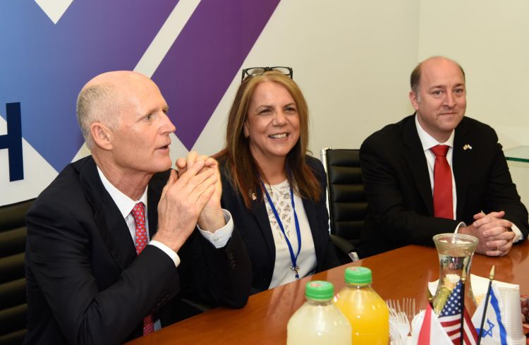 From left, Gov. Rick Scott, Dr. Vicki Rabenou and A.J. Ripin