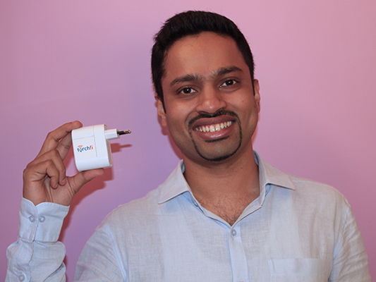 Anup Balagopal, Torchfi Founder and CEO, with the Torchfi device