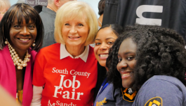 Sandy Murman, second from left, organizes job fairs to get people back to work.