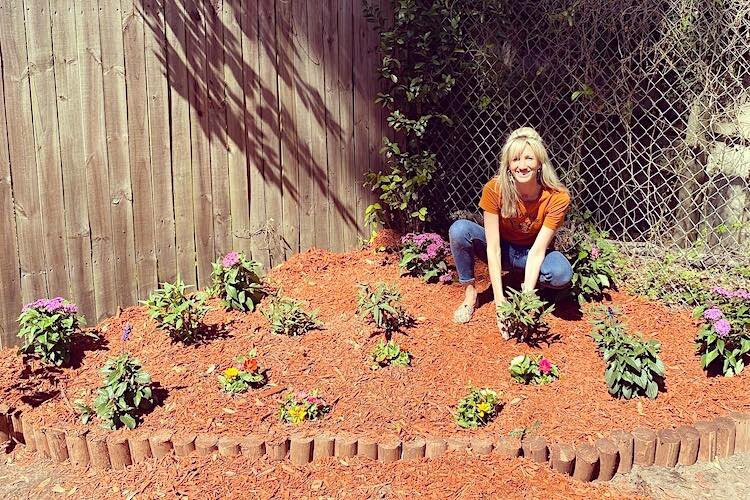 Gloria Brooks plants magnolia, milkweed, porter weed, and passion vine in her butterfly garden.