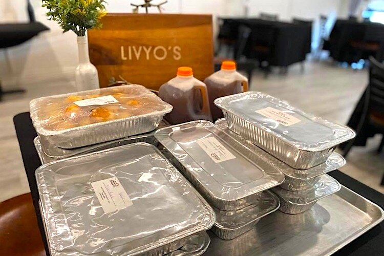 Family-style meals headed out the door at Livy O's Catering and Events in Brandon.