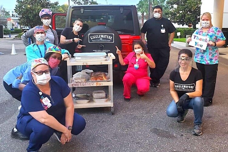 Gigglewaters staff delivers hot meals to first responders at John Hopkin's All Childrens Hospital in St. Pete.