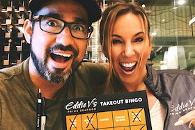 Eddie V's Executive Chef Taro Larrea and Sales Manager Kim Kramer with Tampa Bay TakeOut Bingo Cards in Tampa.