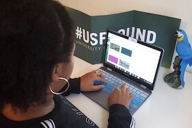 Caitlyn Coleman, a first-year microbiology student, at USF transitions to online classes at USF.