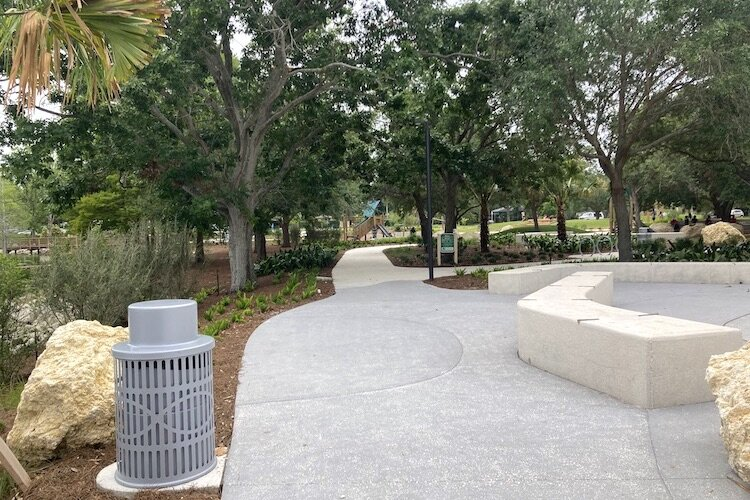Paved trails invite families to stroll, walk, run, or bicycle the day away in refurbished green space near downtown Clearwater.