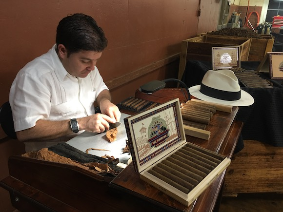 A cigar roller at J.C. Newman Cigar Company puts finishing touches on cigars.