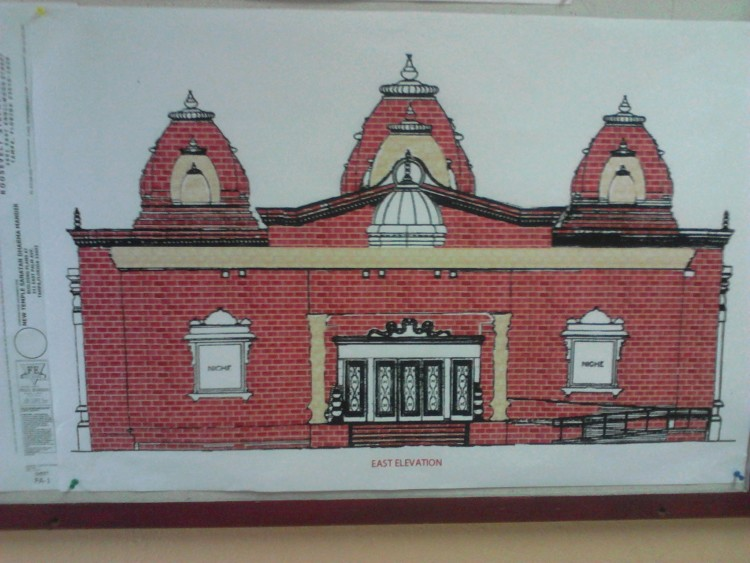 The facade of the new Hindu temple will be red brick and have five rising towers atop the roof.