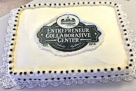 A celebratory cake marks the creation of the ECC in 2014.