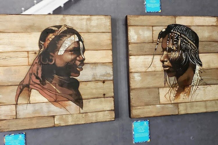 Herbert Scott Davis portraits on wood at Second Century Studio.