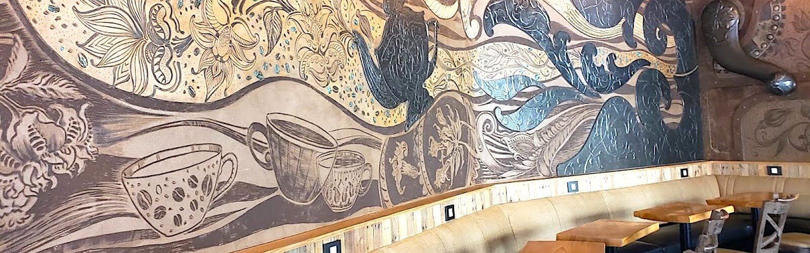 Funky murals on the walls of Grindhouse set the atmosphere for sipping coffee and sharing stories.