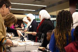 People of all faiths gather for special Thanksgiving dinner welcoming refugees to Tampa.