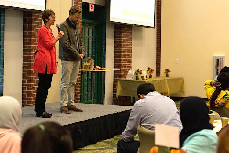 Pastors Sally Campbell-Evans of Hyde Park's United Methodist Church and Will Wellman of Palma Ceia Presyberian lead the Tampa Bay Refugee Task Force and guests in prayer.