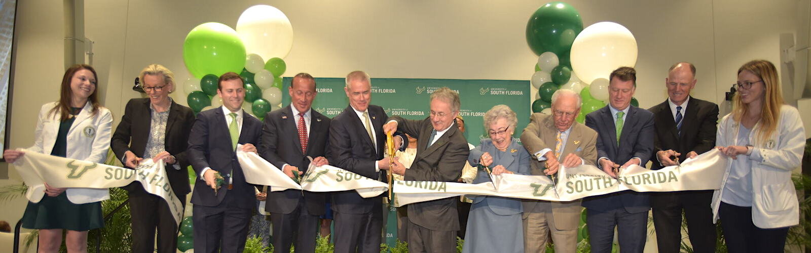 Dignitaries led by philanthropists Carol and Frank Morsani, USF Health VP Charles Lockwood, and Tampa Mayor Jane Castor cut the ribbon to the new USF Med School.