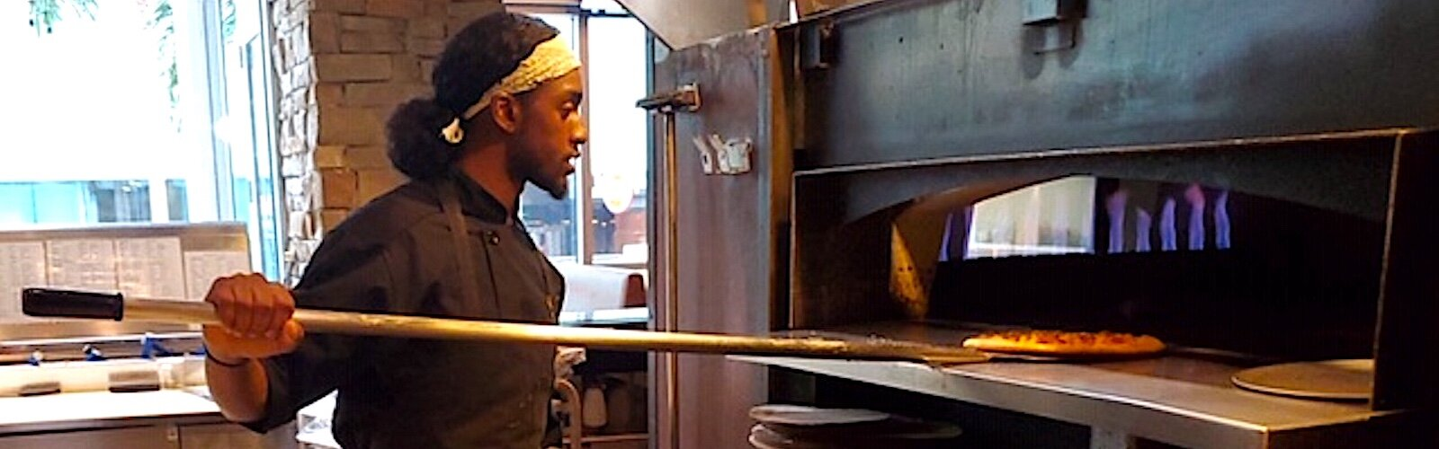 Scholarship winner Lavante Pope puts his training to work at Oak and Stone in St. Petersburg.