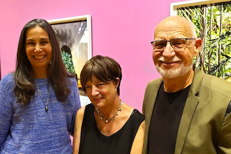 Artists Carole Mickett and Robert Stackhouse catch up with Noel Smith, Deputy Director of USF CAM/Curator, Latin American & Caribbean Art (center). Mickett and Stackhouse are featured in 'As the Gulf Turns' at HCC-Ybor, Feb. 6-March 20.