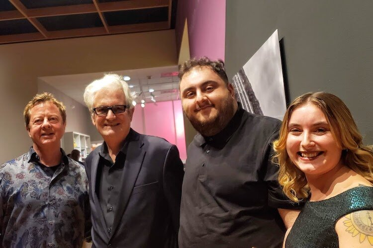 Local art collector Stanton Storer and Yann Weymouth, chief architect of the Dali Museum and the James Museum of Western and Wildlife Art, with USF seniors in Humanities Rami Mohammad and Emily Gregoire.