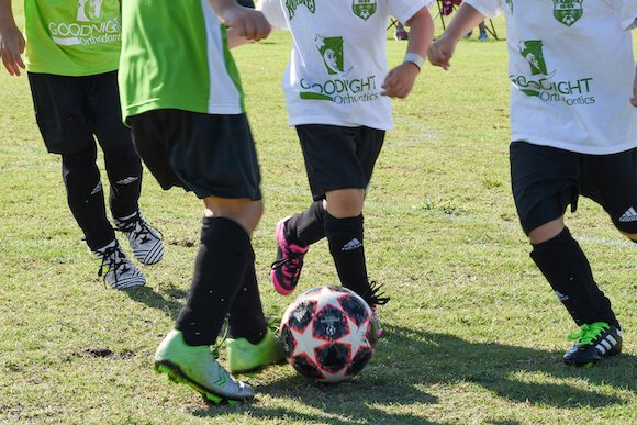 Play it Forward assists with soccer equipment and fees so every child, regardless of family income, can play.