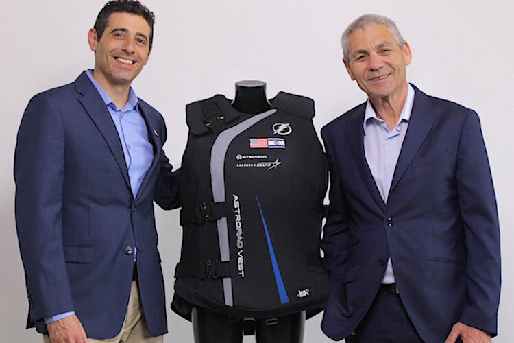 Oren Milstein, PhD. (CEO, co-founder, and chief scientific officer) and Avi Blasberger, director-general of Israel Space Agency, with StemRad's AstroRad.