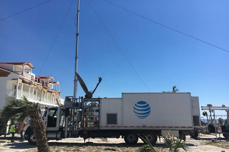 AT&T repair trucks move in asap following hurricanes in Florida to repair damage.