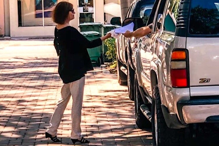 Susan Dennison provides curbside service at Majesty Title in Tampa.