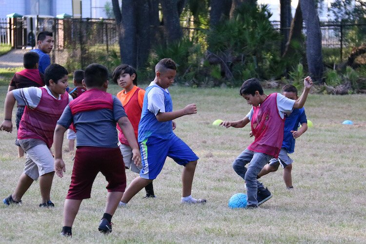 Organized leagues as well as pickup games of soccer and other sports help build a sense of community.