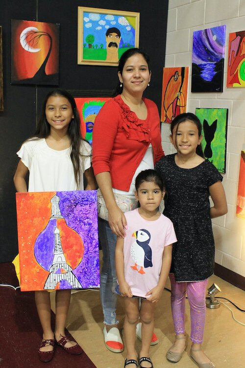Arts programs provided by the University Area CDC invite participation from all ages.