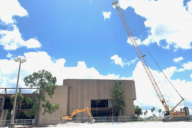A crane prepares to work on the old JCPenney building at University Mall in north Tampa.
