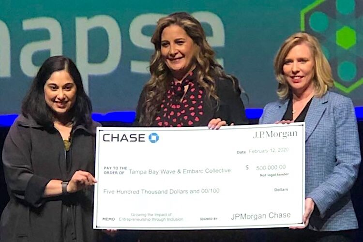 Lakshmi Shenoy of Embarc Collective (left) and Linda Olson of Tampa Bay Wave (right) receive a $500,000 grant from Michele Grace of JPMorgan Chase to launch the TechWomen Rising Accelerator.
