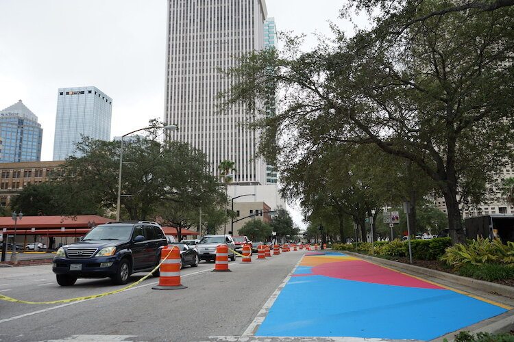 New murals create a colorful street scene along Ashley Drive for motorists entering and exiting the city off I-275.