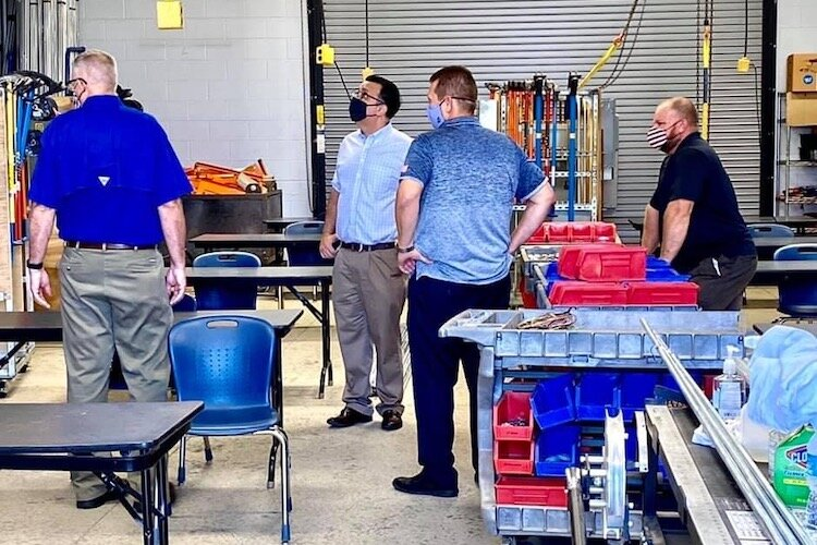 Tampa City Council member Luis Viera (in lightest blue shirt) tours International Brotherhood of Electrical Workers Chapter 915 in Tampa.