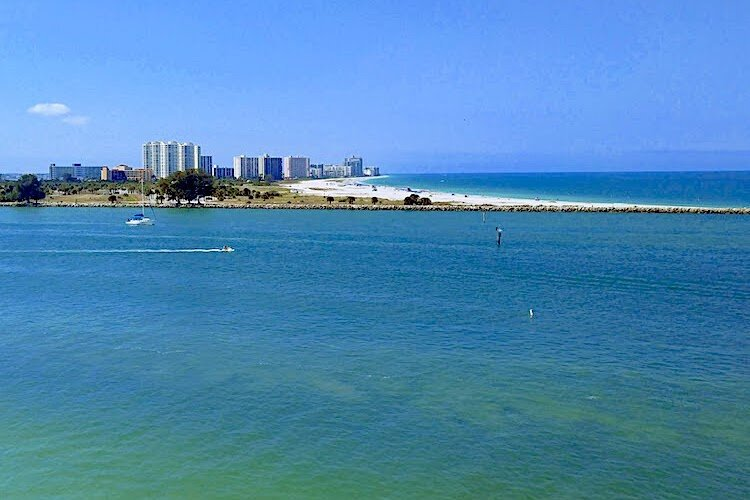The Clearwater skyline and famous white sand beaches bordering the Gulf of Mexico.