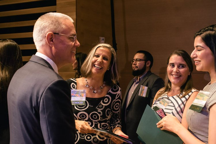 USF President Steven C. Currall congratulates scholarship winners.