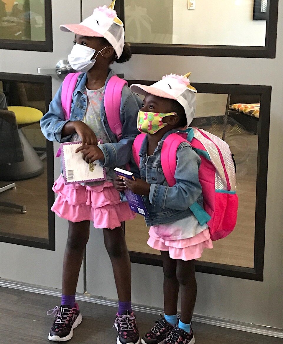A backpack giveaway at ENCORP! ensured children living in public housing were ready for the start of school.