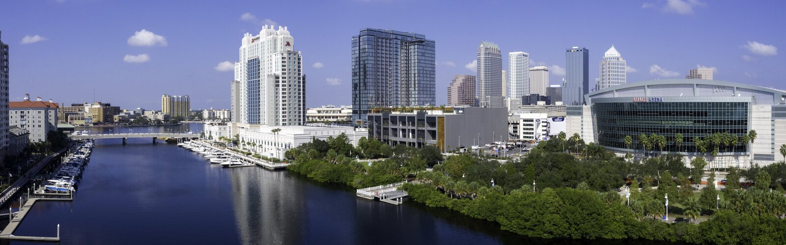 The new JW Marriott Hotel stands out between the Marriott Waterside and Amalie Arena in the Water Street Tampa development.
