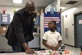 THAP CEO Derrick Blue volunteers at Potter Elementary in East Tampa.