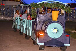 The Winter Village Choo-Choo, a 12-seat, three-car trackless train, makes 10-minute loops around Curtis Hixon Waterfront Park during the evening light shows. Train cars are limited to one family at a time due to COVID.