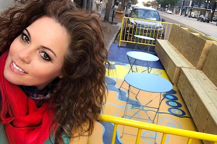 Artist Nicole Peasley painted a mural to enhance the dining experience within one parklet.