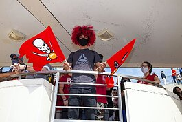 Tampa's Elio Peguero, 20, sported his custom haircolor to celebrate the Super Bowl LV Champion Tampa Bay Bucs' win over the Kansas City Chiefs.