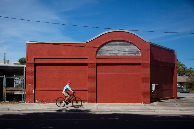 A man cycles down North Fort Harrison in Clearwater where the city plans to put the North Ward Elementary School on the historic registry and give new life to the building.