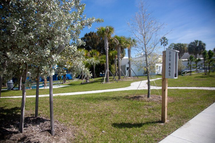 A dog walk and dog bags with new landscaping and seated areas are provided for guests at the Seminole Boat Ramp.