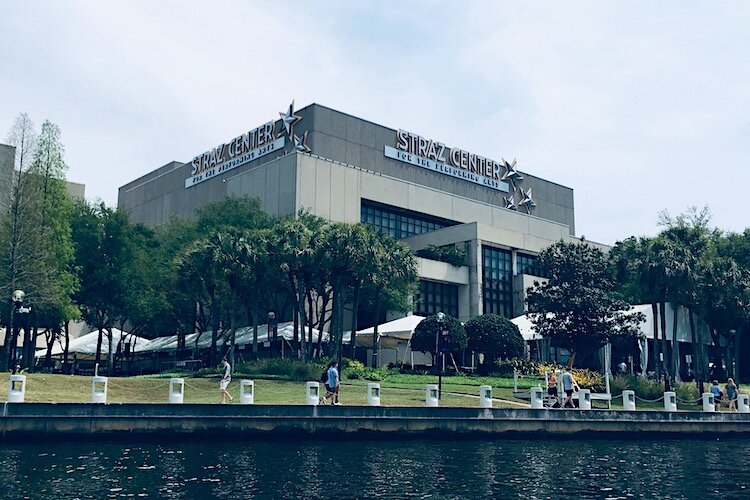 The Straz Center on The Tampa Riverwalk as seen from a passing boat.