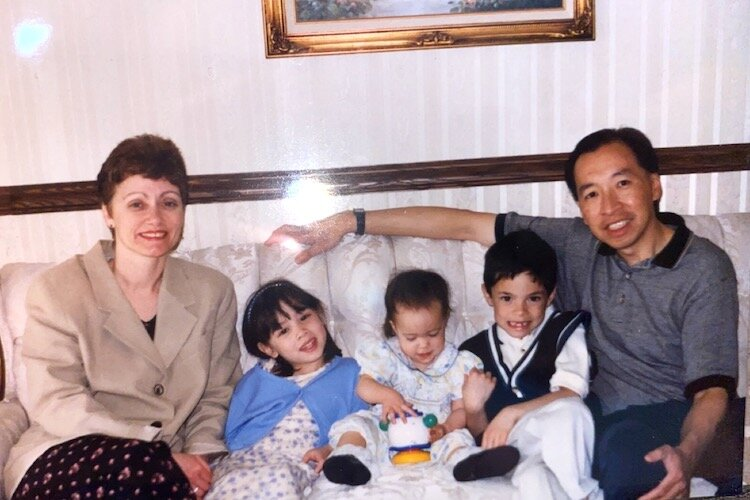 Lauren Wong as a toddler with her older siblings and parents.