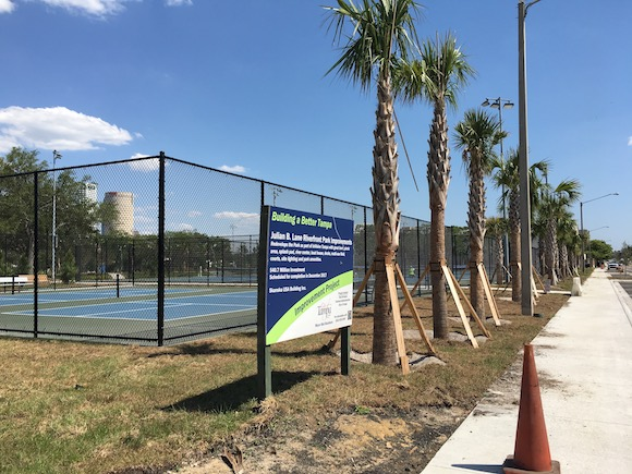 New trees and tennis courts are part of new Julian B. Lane Park on North Boulevard.