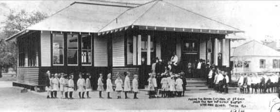 Boys and girls lined up in 1914 outside lunch room at Gorrie Elementary for first hot lunch served at Tampa school.